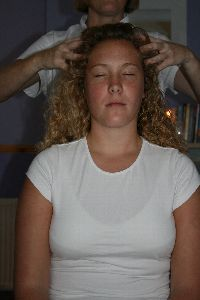 An image of a client undergoing an Indian Head Massage Treatment